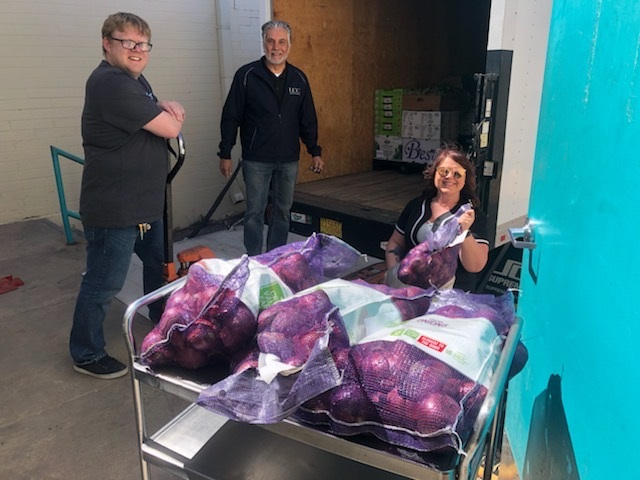 LDC Food and Beverage Team Members Load Food Donations